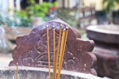 Burning incense sticks. In a special decorated bowl Royalty Free Stock Photography