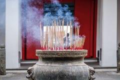 Burning incense sticks Stock Images