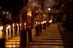 Burning Incense sticks and candle Royalty Free Stock Photo