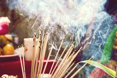 Burning incense sticks Embossed in an incense pot. There is a lot of smoke royalty free stock image