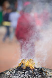 Burning incense sticks outside a temple Royalty Free Stock Images