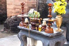 Burning incense sticks in a special bowl on the table with dona. Tions Vietnam,Nha Trang City, complex of temples Po Nagar Cham Towers 2018-01-07 Stock Image