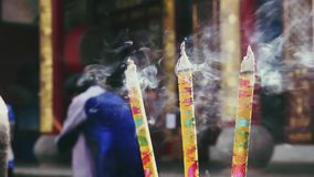 Burning incense in  traditional Chinese Buddhist temple. Chinese Buddhist temple in Kunming. Certain parts of population in Yunnan still practise religion in stock video footage