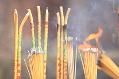 Burning incenses in temple Royalty Free Stock Image