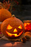 Burning Jack O'Lantern on a rustic table Royalty Free Stock Photo