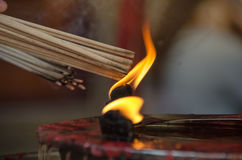 Burning the joss stick. At chinese temple Royalty Free Stock Images