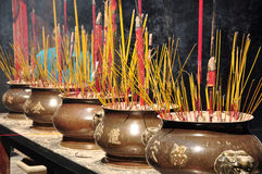Burning joss sticks Stock Photos