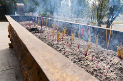 Burning joss sticks Stock Photo