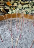 Burning Joss Sticks in brass pot in the temple Stock Image