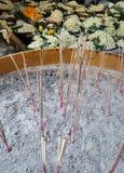 Burning Joss Sticks in brass pot in the temple Stock Image