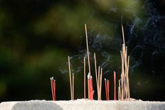 Burning joss sticks Royalty Free Stock Photo
