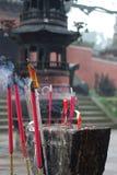 Burning josssticks   Arkivfoto