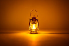 Burning kerosene lamp background Royalty Free Stock Photo