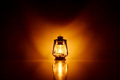 Burning kerosene lamp background Stock Photos