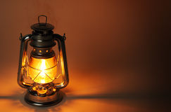 Burning kerosene lamp in dark Stock Images
