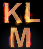 Burning KLM letters, burning alphabet Royalty Free Stock Photo