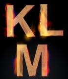 Burning KLM letters, burning alphabet. Burning KLM letters over dark,alphabet, illustration Royalty Free Stock Photo