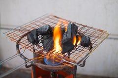burning kol arkivfoton