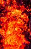 burning kol för bakgrund Arkivfoto