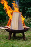 Burning Laminate panels in open fire on a grill place Stock Photos