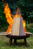 Burning Laminate panels in open fire on a grill place Royalty Free Stock Photo