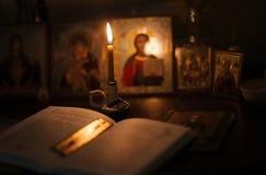Burning lamp with orthodox icons Stock Photo