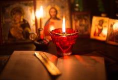 Burning lamp with orthodox icons Stock Image