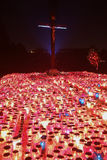 Burning lampions beneath cross Stock Photography