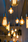 Burning lamps in retro style under the ceiling Stock Photography
