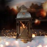 Burning lantern in snow Royalty Free Stock Photo