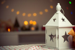 Burning lantern and christmas decoration with bokeh in the eveni Stock Image