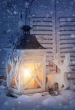 Burning lantern and christmas decoration Stock Image