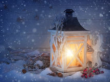 Burning lantern and christmas decoration Royalty Free Stock Photo