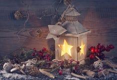 Burning lantern and christmas decoration stock image