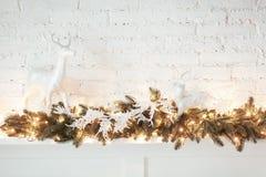 Burning lantern and christmas decoration on white background. Xmas tree. Candleholder house. Bed with pillow.  Stock Images
