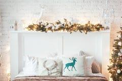 Burning lantern and christmas decoration on white background. Xmas tree. Candleholder house. Bed with pillow.  Stock Photo