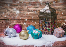 Burning lantern and Christmas decorations. In the snow Royalty Free Stock Images
