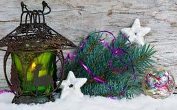Burning lantern with fir branch Royalty Free Stock Image