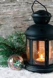Burning lantern with fir branch Stock Photos