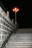 Burning lantern and ladder, disappearing into darkness. Royalty Free Stock Photos