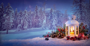 Burning lantern in the snow Stock Photography