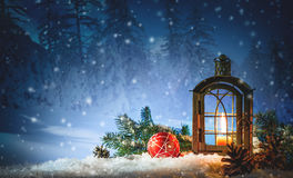 Burning lantern in the snow. Christmas background Stock Image