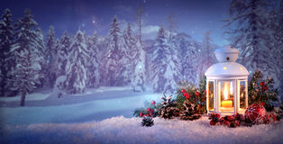 Burning lantern in the snow Royalty Free Stock Images