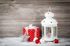 Burning lantern in the snow with christmas decoration Stock Image
