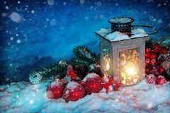 Burning lantern. In the snow at night stock photo