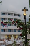 Burning lantern wrapped with flowers in front of the hotel stock photography