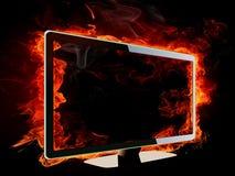 Burning lcd tv. On black background Stock Images