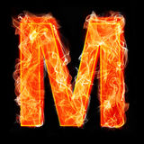Burning letters as alphabet type M. Burning letters as alphabet type Stock Photo