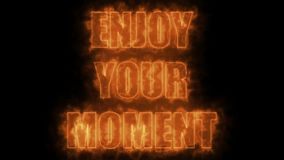 Burning letters of Enjoy your moment text on black, 3d render background, computer generating. Burning letters of Enjoy your moment text on black, 3d rendering Royalty Free Stock Photos