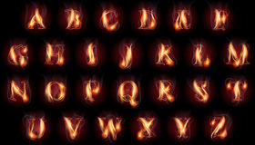Burning letters set. Set of fire burning latin alphabet letters Royalty Free Stock Photo